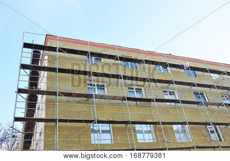 Exterior house wall heat insulation with mineral wool building under construction. The more heat flow resistance your insulation provides the lower your heating and cooling costs.