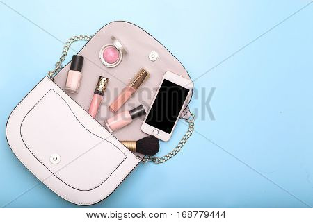 Woman Beauty Accessories. blue background. flat lay