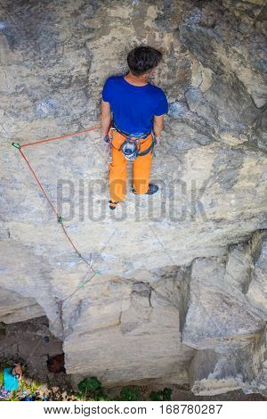 Rock Climber Resting On A Rock.