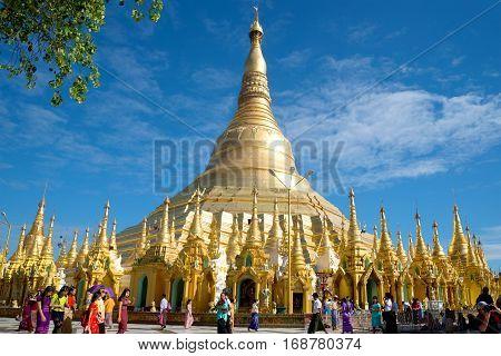 YANGON, MYANMAR - DECEMBER 17, 2016: Stupa of the Shwedagon pagoda on a Sunny day