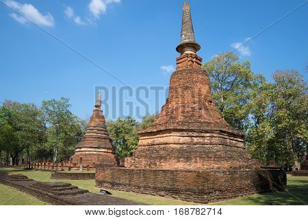 Two chedi on the ruins of ancient Buddhist temple Wat Phra That. Kamphaeng Phet, Thailand