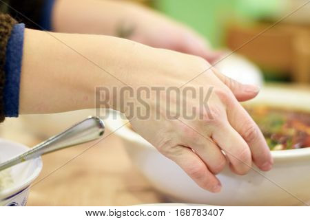 Woman Hands Passing Bowl Of Soup