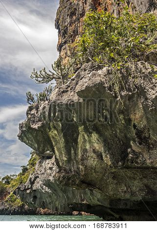 Thailand Krabi province near the village of Ao Nang. Unusual beach Reilly; bizarre as if carved karst cliffs.