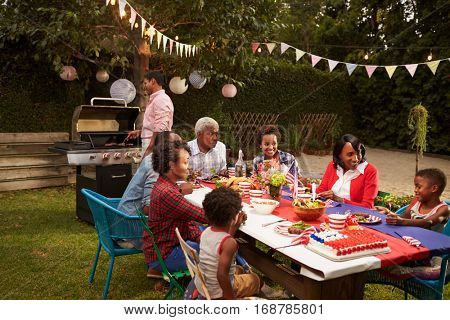 Multi generation black family having a 4th July barbecue