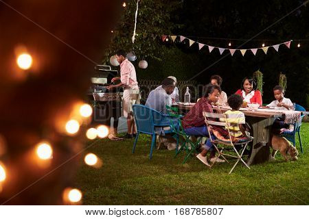 Multi generation black family enjoying a barbecue dinner