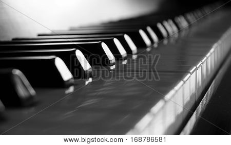 Closeup of soft focus piano keys. Close frontal view. Feelling blue.
