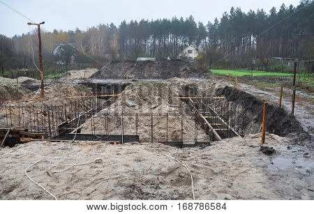 Formwork for the concrete foundation building site. A fundament at a building site. Outdoors