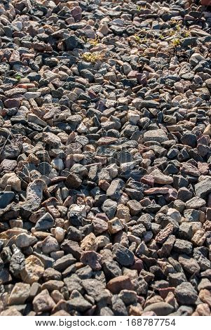 The texture of small stones closeup. Placer gravel, pebbles