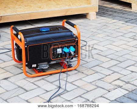 Mobile Gasoline Generator on the Building Site. Mobile Backup Generator. Standby Generator - Outdoor Power Equipment. Standby Generator.