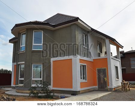 Painting and Plastering Stucco  Exterior House Wall. Facade Thermal Insulation and Painting Works During Exterior Renovations