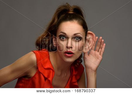 Shocked Young Woman Secretly Listening Conversation