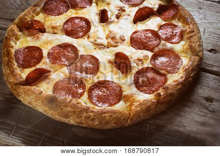 Pizza Pepperoni On Wooden Table