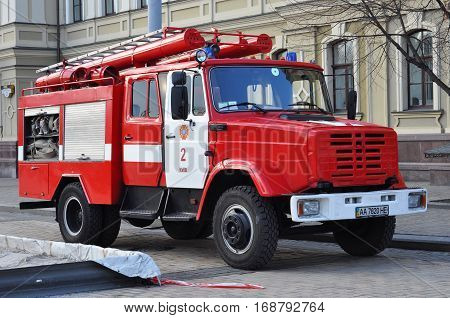 KYIV UKRAINE - FEBRUARY 5 2017: Red firetruck Kraz ride on call fire suppression