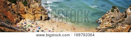 Algarve coastline in Portugal. Famous Camilo Beach in Lagos, Algrave, Portugal. Popular touristic place in Portugal, ocean beach