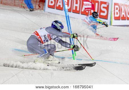 STOCKHOLM SWEDEN - JAN 31 2017: Alexis Pinturault (FRA) and competitor squirting snow in the downhill skiing in the parallel slalom alpine event Audi FIS Ski World Cup. January 31 2017 Stockholm Sweden