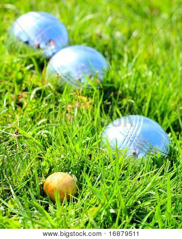 Bocce ball on a green grass. Close up with shallow dof.