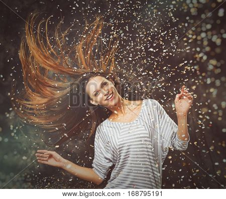 Cheerful Young Woman Throwing Confetti