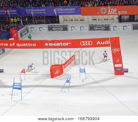 STOCKHOLM SWEDEN - JAN 31 2017: Dave Ryding (GBR) and competitor passing the finish line in the downhill skiing in the parallel slalom alpine event Audi FIS Ski World Cup. January 31 2017 Stockholm Sweden