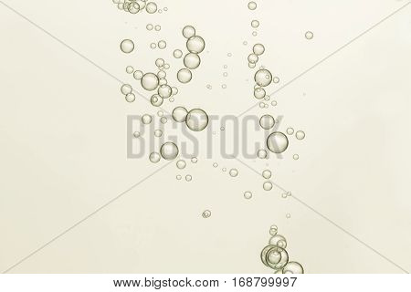 Flowing air bubbles is isloated over a light background