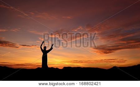 Jesus Christ statue over sunset background religion and spirituality concept