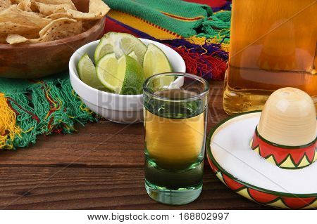 Tequila shot with limes, salt, chips and Mexican blanket. Great for Cinco de Mayo themed projects or Mexican restaurants.