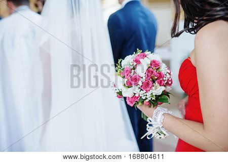 Bridesmaids with flowers, wedding day the happiest