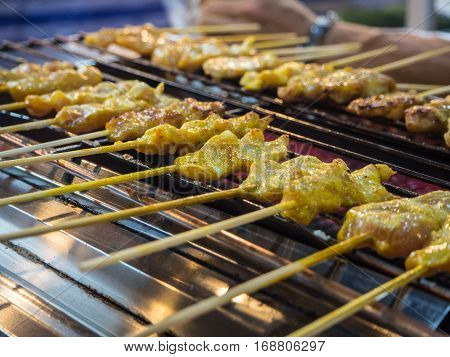 yellow Grilled porks satay on a hotplate