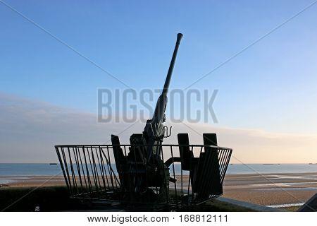 Anti-aircraft gun at Arromanches in Normandy, France