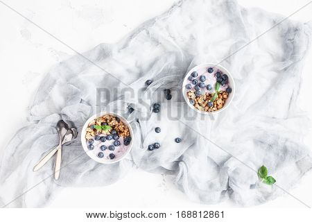 Healthy breakfast with yogurt muesli and berries. Flat lay top view