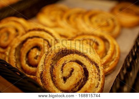 food, baking, sweets and sale concept - close up of buns at bakery or grocery store