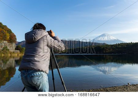 Woman taking photo on Mount Fuji