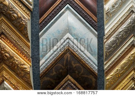 Craftsman working on frame in frame shop. Professional framer hand holding frame angle. Top view.
