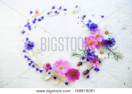 Flower composition on the wooden white background
