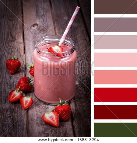 A strawberry smoothie in a jar with straw, vintage style over old wood background, in a colour palette with complimentary colour swatches.