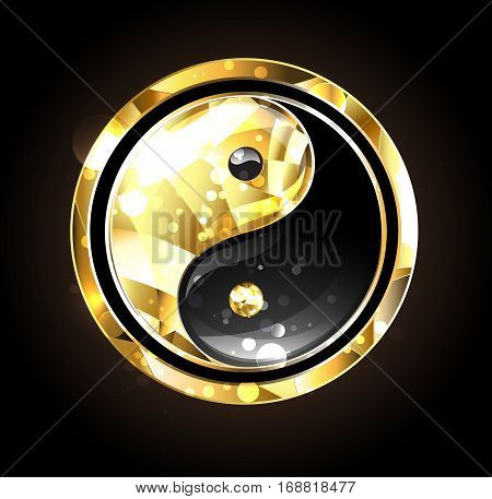 Jewelry gold and black yin yang symbol on a black background. Gold yin yang.