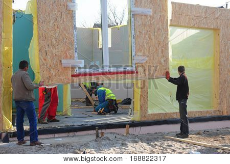 KIEV UKRAINE - January  23 2017: Builders Install SIP panels for New Frame House Construction. SIP panels good for energy efficient building systems.
