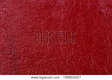 Red leather texture background. Leather craft. Copy space for text.