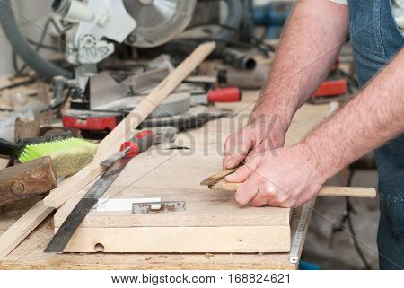 Carpenter tools on wooden table with sawdust. Circular Saw. Cutting a wooden plank.