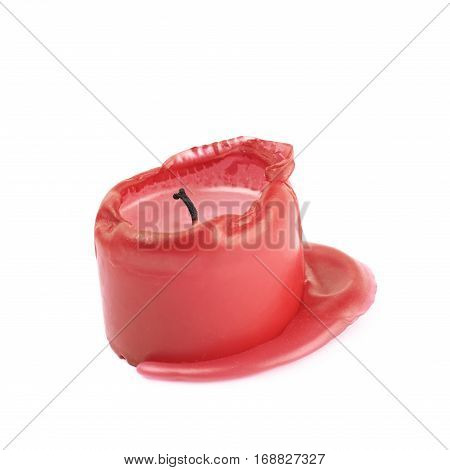 Single burned to the end red candle isolated over the white background