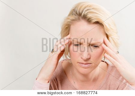 Lady Holds Head And Looks Tense With Copy Space