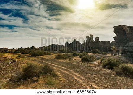 picturesque view of Lanzarotte desert with cliffs and blue cloudy sky on the background, Canary Island