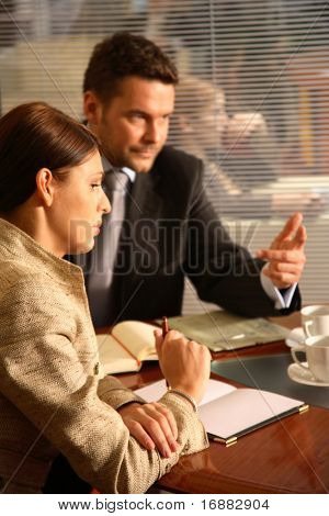 Professional businesspeople in an office environment - debate
