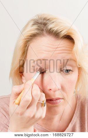 Blonde Lady Applying Eyeshadow