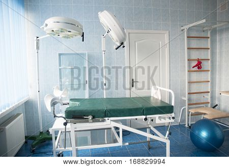 Childbirth hospital room with gymnastics wall bars. Delivery room