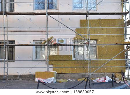 KIEV UKRAINE - January 23 2017: Energy efficiency house wall renovation for energy saving. Exterior house wall heat insulation with mineral wool building hospital under construction.