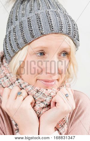 Woman Wearing Scarf And Winter Hat Looking Away