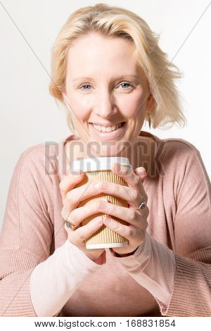 Blonde Woman At Direct Gaze Holding A Paper Cup