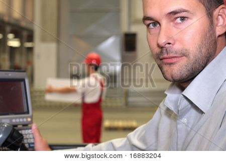 engineer in factory,worker with box in background