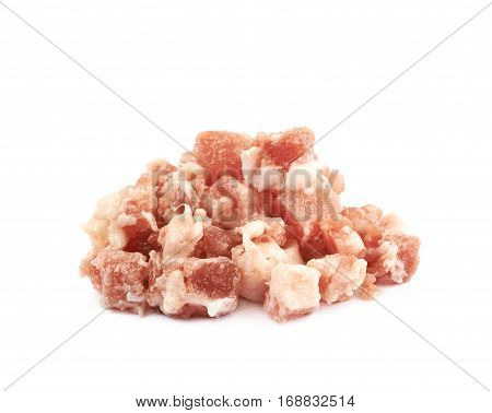 Pile of raw bacon cube bits isolated over the white background
