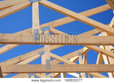 Wooden Roof Frame House Construction. Close up on wooden beam and rafters